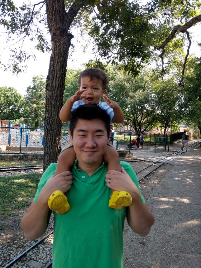 Dad holding toddler on shoulders in Zilker Park - Austin, TX family-friendly itinerary