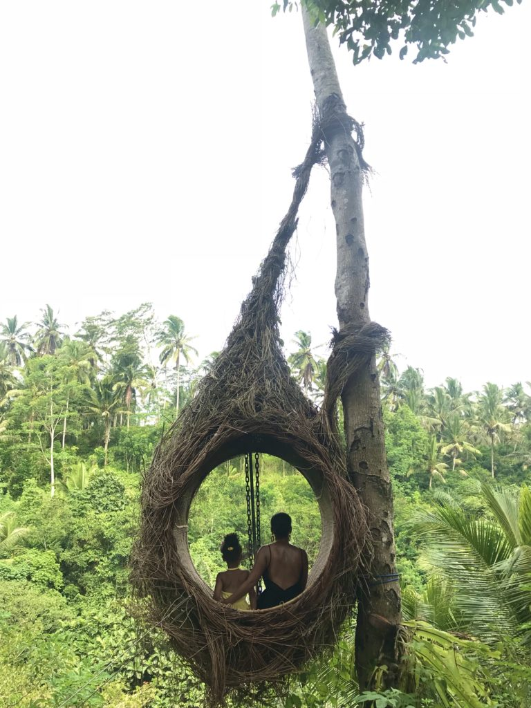 Black mom and daughter sitting in Bali nest egg