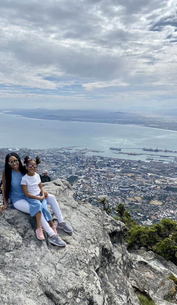 Black mom and daughter Cape Town lookout rock - diversity in family travel
