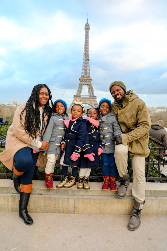 Black family with kids in front of Eiffel Tower
