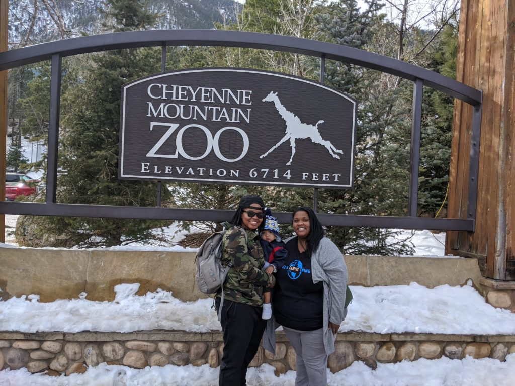 Black moms at zoo with son - diversity in family travel