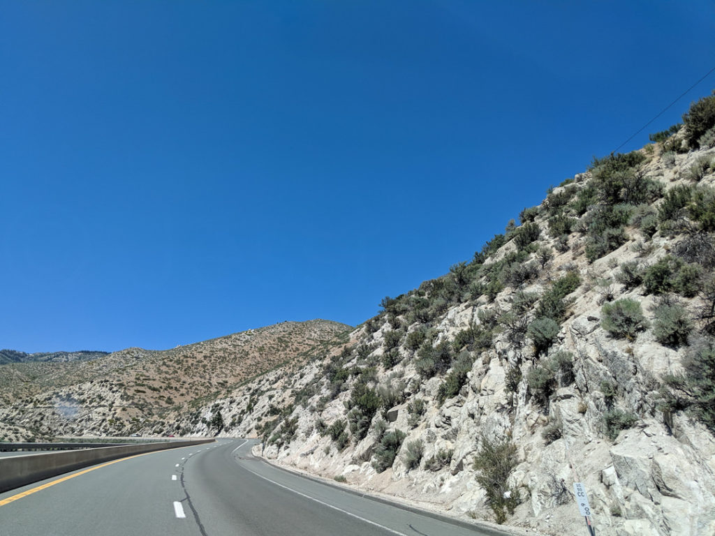 Desert hills open road highway - family vacation covid