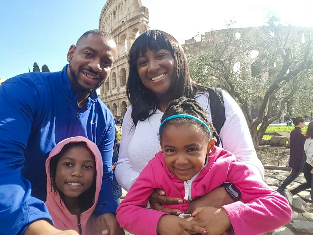 Black family with girls seeing the Colosseum - diversity in family travel
