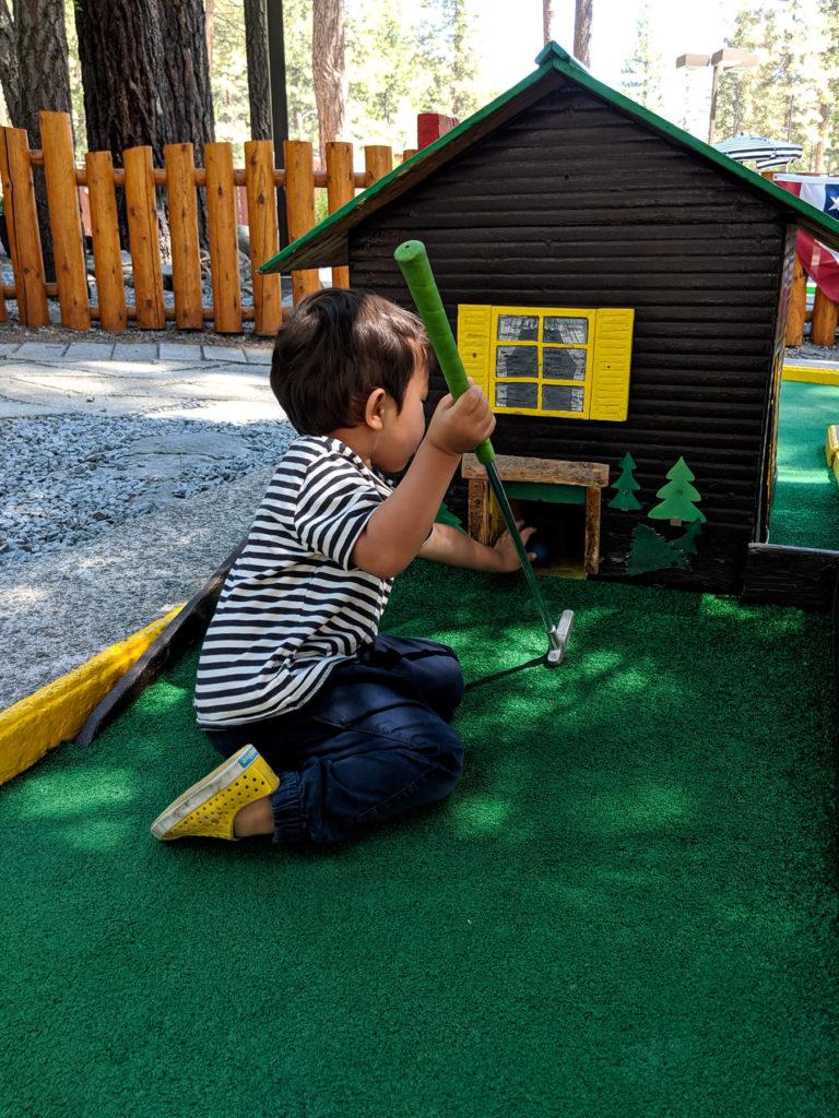 Toddler kneeling mini golf house - Kings Beach